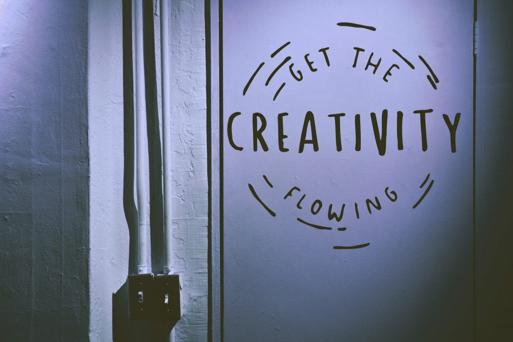 a sign to remind artists to create instead of imitate