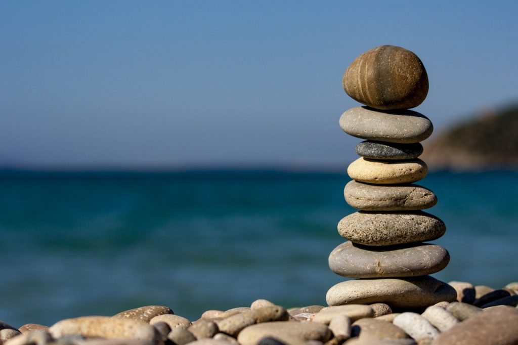 stacked rocks to symbolize balance of resting and working on art