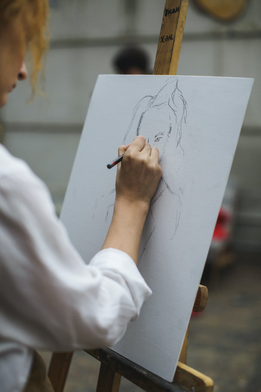 Artist drawing on a canvas